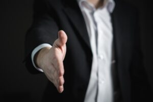 Ominous handshake from the faceless man of digital agencies. Do you trust him?